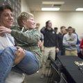 Bentonville High senior Cash Jones (left) carries his friend, Jackson Visser, 15, after signing a le...