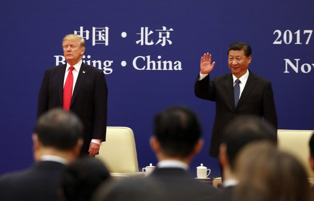 us-president-donald-trump-left-and-chinese-president-xi-jinping-attend-a-business-event-at-the-great-hall-of-the-people-in-beijing-thursday-nov-9-2017-ap-photoandrew-harnik