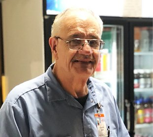 Submitted photo CONSUMER OF THE YEAR: David Cox, at his vending stand inside the Arkansas Career Training Institute, was recently named a DHS Division of Services for the Blind Hot Springs area Consumer of the Year.