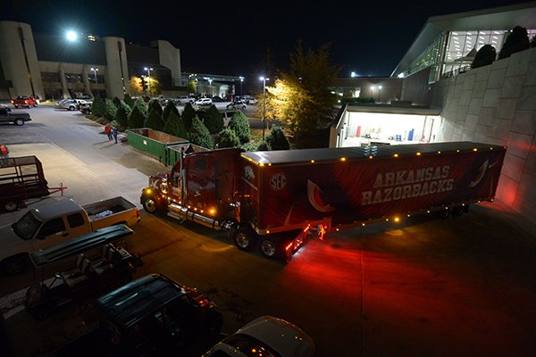 A semi-truck and trailer prepares to leave the Fred Smith Football Center Thursday, Nov. 9, 2017, before heading out to Baton Rouge, La., ahead of the Razorbacks' game with LSU Saturday. Jerry Rico of Fayetteville and Rodney Collins of Pensacola, Fla., are employees of J.B. Hunt Transport and the work together to drive equipment necessary for the Razorbacks football team to and from games away from Fayetteville.