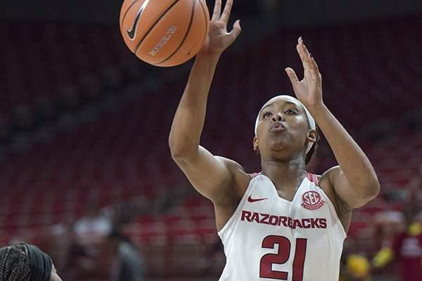 Arkansas guard Devin Cosper (21) attempts a shot during a basketball game on Thursday, Nov. 2, 2017 at Bud Walton Arena in Fayetteville.