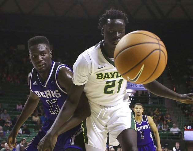 baylor-forward-nuni-omot-and-central-arkansas-forward-otas-iyekekpolor-watch-as-the-loose-ball-goes-out-of-bounds-in-the-second-half-friday-nov-10-2017-in-waco-texas