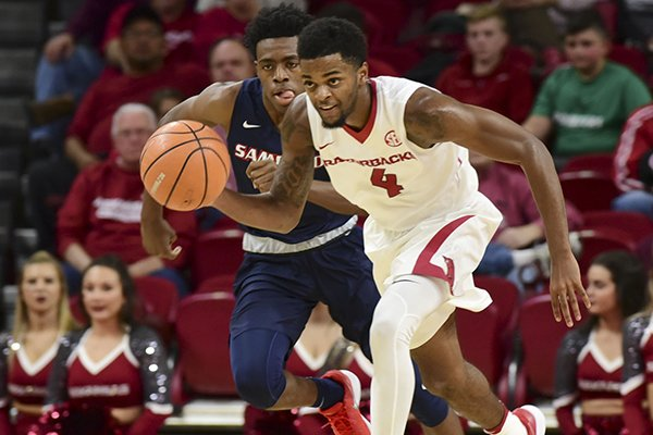 Arkansas guard Daryl Macon dribbles up the floor during a game against Samford on Friday, Nov. 10, 2017, in Fayetteville.