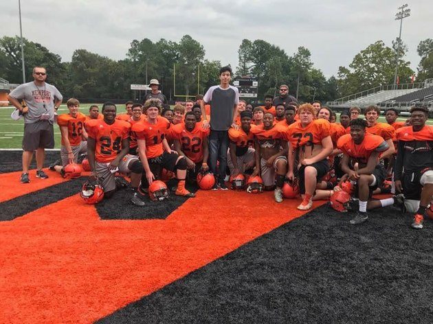 ninth-grader-abraham-gomez-center-is-surrounded-by-newport-teammates-and-coaches-gomez-was-diagnosed-with-cancer-earlier-this-year