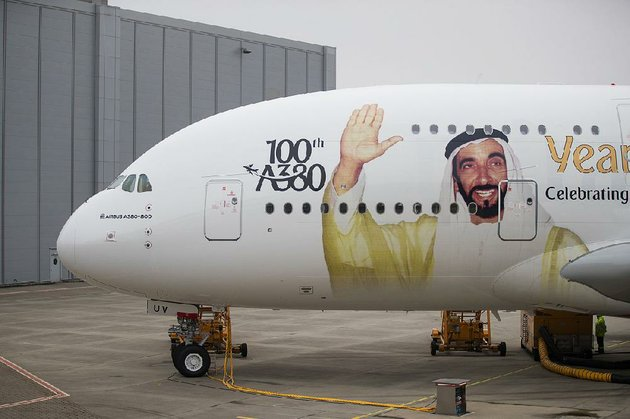 a-portrait-of-sheikh-ahmed-bin-saeed-al-maktoum-chief-executive-officer-of-emirates-airlines-adorns-an-airbus-se-a380-aircraft-as-emirates-take-delivery-of-their-100th-a380-passenger-jet-in-hamburg-germany-in-early-november
