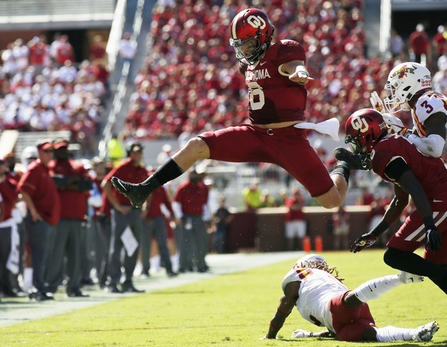 file-in-this-oct-7-2017-file-photo-oklahoma-quarterback-baker-mayfield-6-leaps-over-iowa-state-defensive-back-demonte-ruth-bottom-in-the-second-quarter-of-an-ncaa-college-football-game-in-norman-okla-the-outright-lead-in-in-the-big-12-conference-is-on-the-line-when-no-5-oklahoma-hosts-no-8-tcu-on-saturday-ap-photosue-ogrocki-file