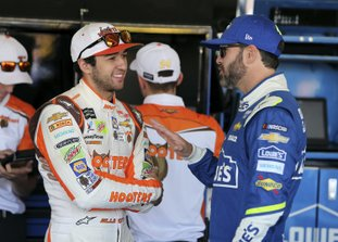 The Associated Press BATTLE IN PHOENIX: Chase Elliott, left, and Jimmie Johnson talk inside the garage area before practice for the NASCAR Cup Series race at Phoenix International Raceway Friday in Avondale, Ariz. Both drivers are looking to fill the final spot for the Championship 4.