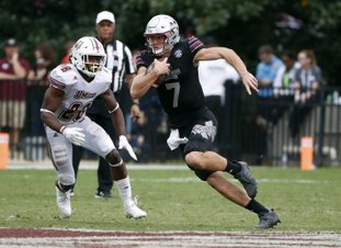 The Associated Press BREAKING FREE: Mississippi State quarterback Nick Fitzgerald (7) runs for a first down past Massachusetts linebacker Jarell Addo (26) in the second half of last Saturday's game against in Starkville, Miss. Mississippi State won 34-23, moving to No. 18 before today's game against Alabama.