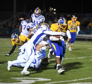 The Sentinel-Record/Mara Kuhn MOVING DOWNFIELD: Lakeside's Dupree Swanson (35) runs the ball as Harrison's Tyler Hutcheson (7) defends during Friday night's first round 5A state playoff game at Austin Field.