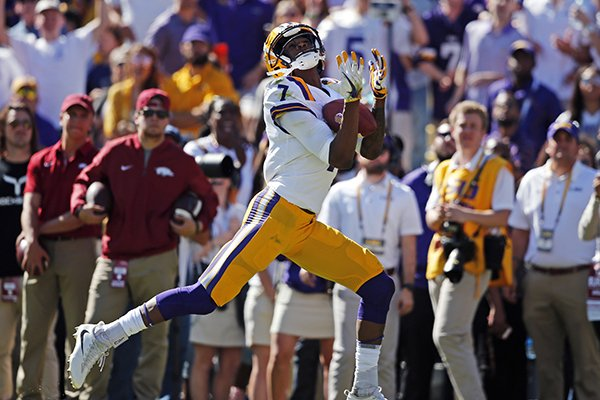 LSU wide receiver D.J. Chark (7) pulls in a touchdown reception in the first half of an NCAA college football game against Arkansas in Baton Rouge, La., Saturday, Nov. 11, 2017. (AP Photo/Gerald Herbert)