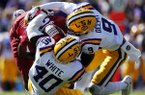 Arkansas running back Devwah Whaley (21)is tackled by LSU linebacker Devin White (40) and safety Grant Delpit (9) in the first half of an NCAA college football game in Baton Rouge, La., Saturday, Nov. 11, 2017. (AP Photo/Gerald Herbert)