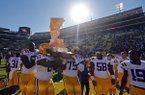 LSU players carry The Boot trophy after an NCAA college football game against Arkansas in Baton Rouge, La., Saturday, Nov. 11, 2017. LSU won 33-10. (AP Photo/Gerald Herbert)
