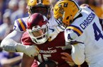 Arkansas quarterback Cole Kelley is stopped short on fourth down by LSU linebacker K'Lavon Chaisson (4) and defensive end Frank Herron in the second half of an NCAA college football game in Baton Rouge, La., Saturday, Nov. 11, 2017. LSU won 33-10. (AP Photo/Gerald Herbert)