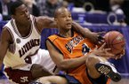 Arkansas guard Jonathon Modica, left, knocks the ball away form Bucknell forward Donald Brown (4) in the first half of their game in the first round of the NCAA tournament in Dallas, Friday, March 17 2006. (AP Photo/ Donna McWilliam)