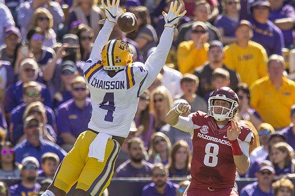 Arkansas quarterback Austin Allen throws a pass between the arms of LSU linebacker K'Lavon Chaisson during a game Saturday, Nov. 11, 2017, in Baton Rouge, La.