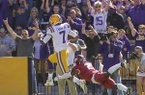 LSU receiver D.J. Chark runs away from Arkansas cornerback Kamren Curl during a game Saturday, Nov. 11, 2017, in Baton Rouge, La.
