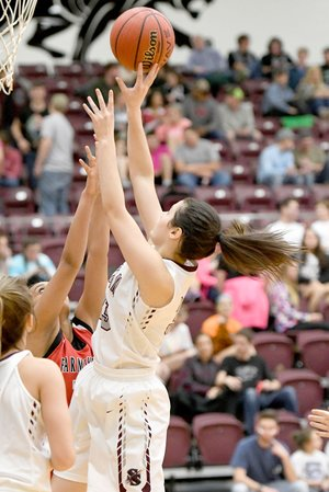 Bud Sullins/Special to Siloam Sunday Siloam Springs senior Hadlee Hollenback fights for a shot in traffic during a game last season against Farmington. Hollenback and the Lady Panthers open the 2017-18 basketball season Tuesday at Rogers Heritage.