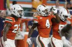 Miami defensive back Jaquan Johnson (4) celebrates after intercepting Notre Dame quarterback Brandon Wimbush during the first half of an NCAA college football game, Saturday, Nov. 11, 2017, in Miami Gardens, Fla. (AP Photo/Lynne Sladky)