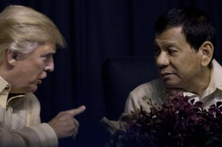 The Associated Press TRUMP: President Donald Trump speaks with Philippines President Rodrigo Duterte Sunday at an ASEAN Summit dinner at the SMX Convention Center in Manila, Philippines.