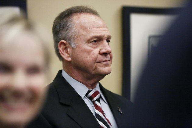 the-associated-press-moore-former-alabama-chief-justice-and-us-senate-candidate-roy-moore-waits-to-speak-the-vestavia-hills-public-library-saturday-in-birmingham-ala-according-to-a-thursday-washington-post-story-an-alabama-woman-said-moore-made-inappropriate-advances-and-had-sexual-contact-with-her-when-she-was-14-moore-is-denying-the-allegations
