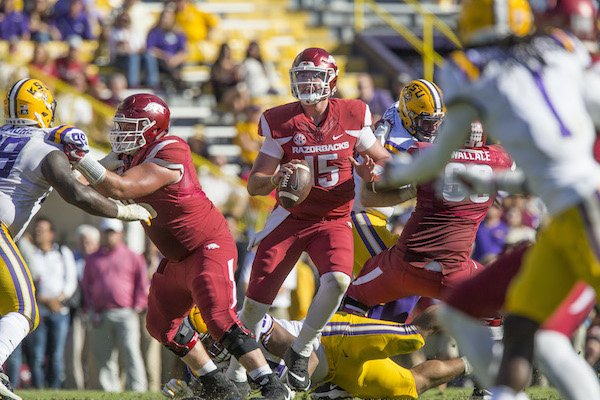 Cole Kelley (15), Arkansas quarterback, looks for a receiver in the fourth quarter against LSU Saturday, Nov. 11, 2017 at Tiger Stadium in Baton Rouge, La.