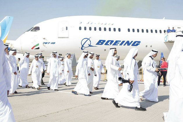 officials-pass-an-emirates-airlines-boeing-787-during-the-dubai-air-show-on-monday