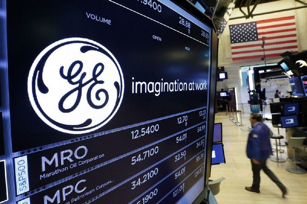 the-general-electric-logo-is-displayed-above-a-trading-post-on-the-floor-of-the-new-york-stock-exchange-in-june-ge-said-monday-that-it-is-cutting-its-quarterly-dividend-by-50-percent-as-the-company-weighs-the-future-of-its-transportation-industrial-and-lighting-businesses-its-most-profitable-divisions