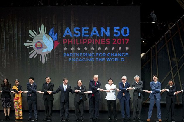 us-president-donald-trump-center-and-other-leaders-do-the-asean-way-handshake-on-stage-during-the-opening-ceremony-at-the-asean-summit-at-the-cultural-center-of-the-philippines-on-monday-in-manila-philippines