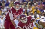 Arkansas center Zach Rogers (75) points out a defender as quarterback Austin Allen (8) prepares to take a snap during a game against LSU on Saturday, Nov. 11, 2017, Baton Rouge, La.