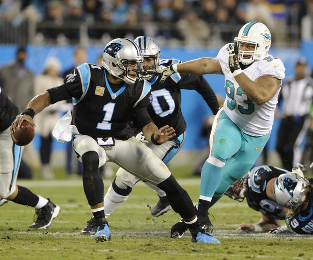 carolina-panthers-cam-newton-1-scrambles-under-pressure-from-miami-dolphins-ndamukong-suh-93-in-the-first-half-of-an-nfl-football-game-in-charlotte-nc-monday-nov-13-2017