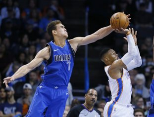 The Associated Press DENIED: Dallas Mavericks forward Dwight Powell (7) blocks a shot by Oklahoma City Thunder guard Russell Westbrook, right, in the second quarter of Sunday's game in Oklahoma City.