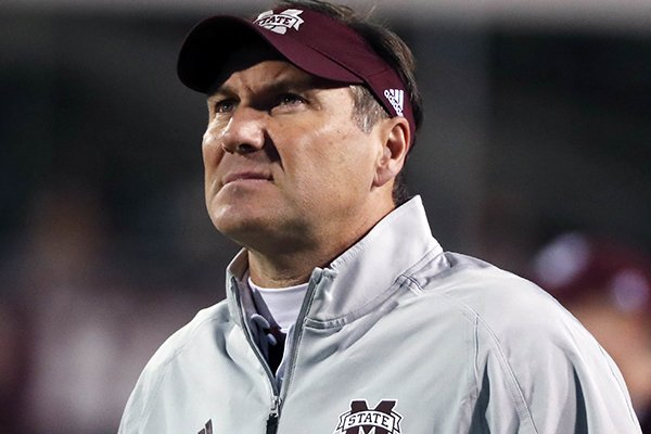 Mississippi State football coach Dan Mullen gives an south oversized monitor a stare during the second half of an NCAA college football game against Alabama in Starkville, Miss., Saturday, Nov. 11, 2017. (AP Photo/Rogelio V. Solis)