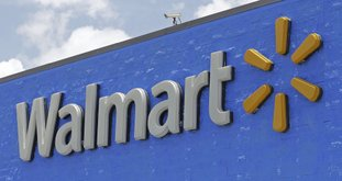 A Walmart sign is seen at a store in Hialeah Gardens, Fla. (AP Photo/Alan Diaz, File)