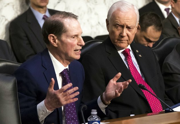 sen-ron-wyden-d-ore-left-the-top-democrat-on-the-senate-finance-committee-criticizes-the-republican-tax-plan-while-chairman-orrin-hatch-r-utah-listens-to-his-opening-statement-as-the-panel-begins-work-overhauling-the-nations-tax-code-on-capitol-hill-in-washington-on-monday-nov-13-2017