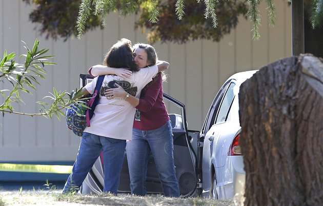 two-women-embrace-outside-rancho-tehama-elementary-school-where-a-gunman-opened-fire-tuesday-nov-14-2017-in-corning-calif