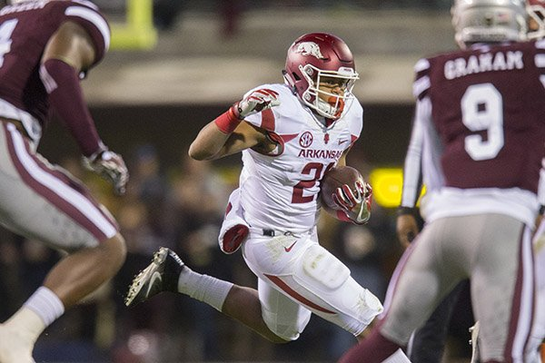arkansas-running-back-devwah-whaley-carries-the-ball-during-a-game-against-mississippi-state-on-saturday-nov-19-2016-in-starkville-miss