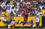 Will Gragg, Arkansas tight end, runs after a catch in the third quarter Saturday, Nov. 11, 2017 at Tiger Stadium in Baton Rouge, La.