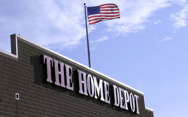 file-in-this-wednesday-may-18-2016-file-photo-an-american-flag-flies-over-a-home-depot-store-location-in-bellingham-mass-ap-photosteven-senne-file