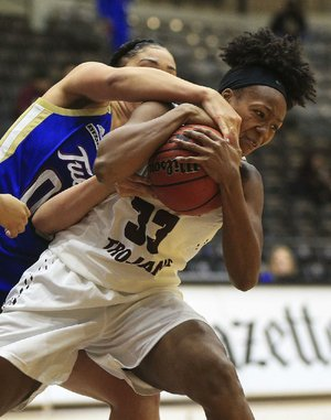 UALR's Keanna Keys (right) and Tulsa's Kendrian Elliott fight for a loose ball Wednesday during the Golden Hurricane's 74-61 victory over the Trojans at the Jack Stephens Center in Little Rock. Keys finished with 11 points and 13 rebounds for the Trojans.
