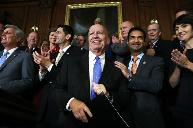 house-ways-and-means-committee-chairman-kevin-brady-center-is-congratulated-thursday-by-fellow-gop-house-members-including-speaker-paul-ryan-left-after-passage-of-the-house-tax-overhaul-plan