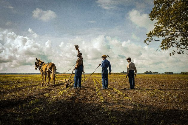 tenant-farmer-hap-jackson-rob-morgan-and-his-sons-marlon-frankie-smith-and-weeks-kelvin-harrison-jr-work-the-soil-in-mudbound