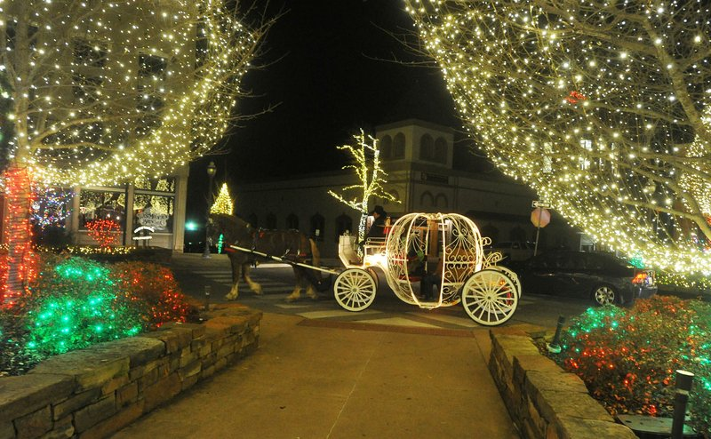 horse drawn carriages will return to the fayetteville square next weekend but the 2017 lights of the ozarks display will be illuminated for the first time