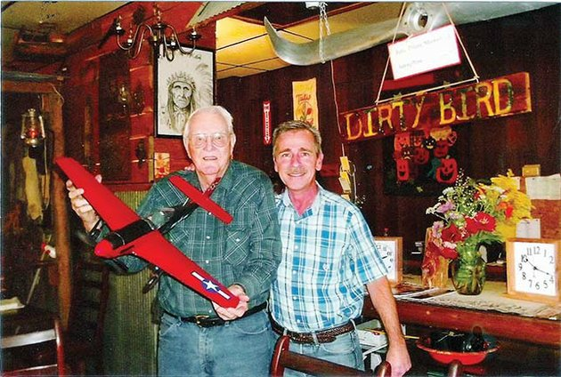 jorli-jc-sikes-88-of-edgemont-holds-a-model-he-made-of-a-p-51-mustang-as-he-stands-with-rob-bentley-owner-of-bentleys-restaurant-in-greers-ferry-sikes-an-air-force-veteran-has-made-14-of-the-world-war-ii-airplane-models-for-the-restaurant