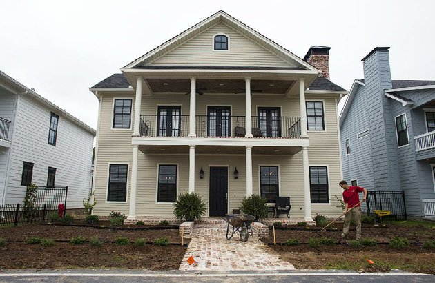 a-landscaper-works-on-the-lawn-of-a-new-house-in-the-rockwater-village-development-in-north-little-rock-in-this-file-photo-construction-work-on-a-new-nearby-development-the-porches-at-rockwater-is-set-to-begin-soon