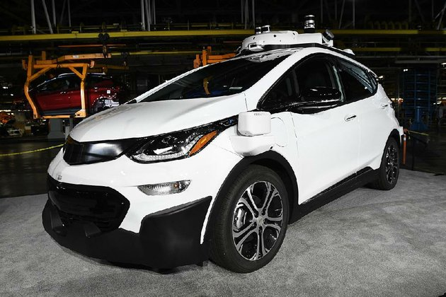 in-this-june-photo-a-self-driving-chevrolet-bolt-ev-that-is-in-general-motors-cos-autonomous-vehicle-development-program-appears-on-display-at-gms-orion-assembly-in-lake-orion-mich