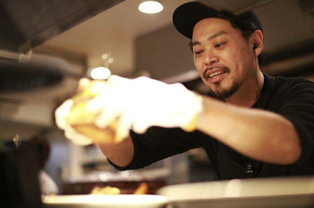 yutaka-yanagisawa-owner-of-munchs-burger-shack-restaurant-prepares-a-burger-at-his-restaurant-in-tokyo-last-week