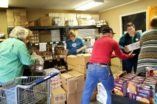 volunteers-and-staff-at-the-conway-ministry-centers-storehouse-client-choice-pantry-in-conway-unload-food-from-donated-shopping-carts-and-sort-them-for-distribution-to-area-families