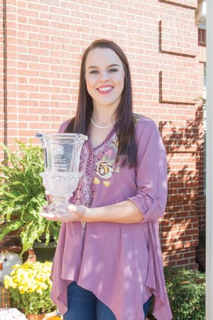 Stephanie Williams of Searcy holds her award for being named to the Arkansas State 4-H Hall of Fame. Williams, a 2015 graduate of Harding Academy, received the award in June. She is the daughter of Bill and Ruth Williams.
