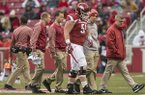 Arkanas offensive lineman Hjalte Froholdt (51) walks off the field with medical personnel during a game against Mississippi State on Saturday, Nov. 18, 2017, in Fayetteville.
