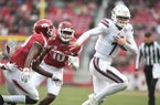 Mississippi State quarterback Nick Fitzgerald (7) is chased by Arkansas defenders during a game Saturday, Nov. 18, 2017, in Fayetteville.